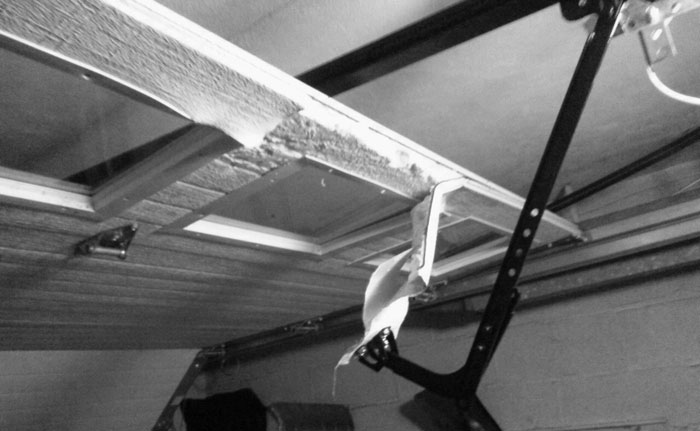 Broken overhead garage door repairer